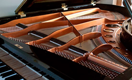 The finished interior of a restored grand piano